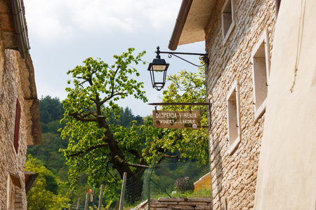 wine store: Molina, Italy - May 07 2016: The pointer to the wine store in the small Italian town of Molina Editorial