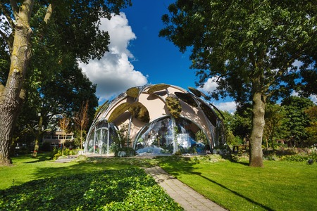 Amsterdam, Netherlands - July 02 2016: The modern round buildings of Ecodome in a garden, sunny day Editorial
