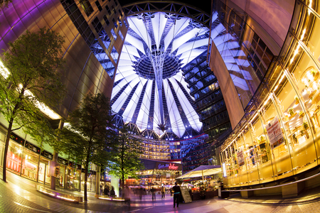 sony: Berlin, Germany - May 10 2013: The modern colorful glass roof of Sony center in Berlin at night time