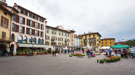 martiri: Lovere, Italy - May 08 2016: People walks on square 13 Martiri in little resort town, summer time Editorial