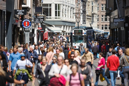 Amsterdam, Netherlands - July 03 2016: Crowd the streets of the city at summer time Publikacyjne