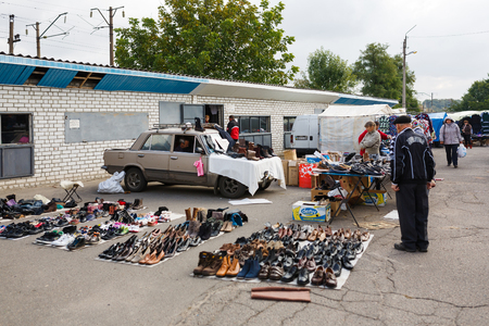 secondhand: Kamianka, Ukraine - September 29 2016: People visit the shoe market of second-hand in a provincial town in Ukraine Editorial