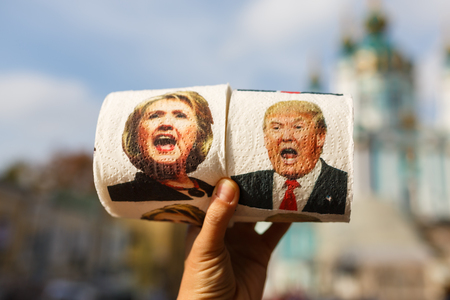 Kiyv, Ukraine - October 02 2016: Man's hand holding a roll of toilet paper with the image of politics