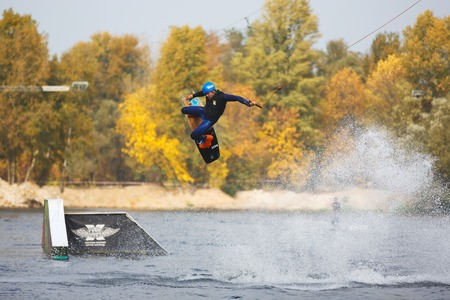 sailboard: Kiyv, Ukraine - October 02 2016: The training of kite surfers on the lake in autumn city