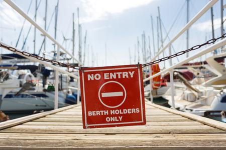 Warning sign at the entrance to the yacht pier, Agios Nikolaos, Greece