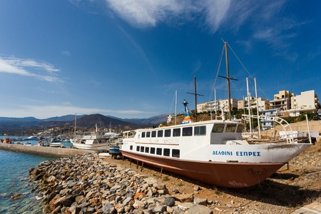 Agios Nikolaos, Greece - October 10 2016: Fishing boat being repaired at the dock on the shore