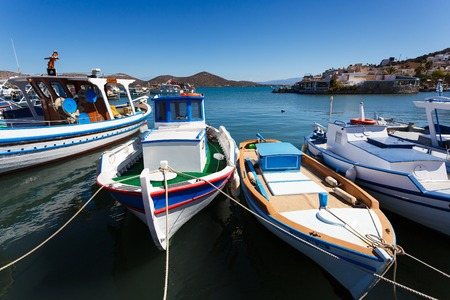 Elounda, Greece - October 14 2016: Fishing boats moored in the port of Elounda, autumn time