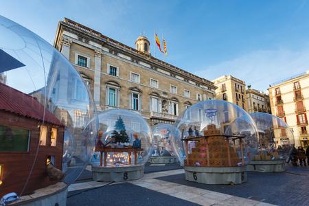 Barcelona, Spain - January 02 2017: Large glass ball at the Plaza de San Jaume, near the Palace of Generalitat of Catalunya Editorial