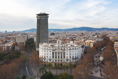 rambla: Barcelona, Spain - January 02 2017: The Palace of Naval Command of Barcelona on the background of the urban landscape Editorial