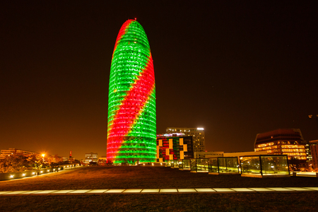 Barcelona, Spain - January 04 2017: Colorful luminous facade of the Agbar tower in the night