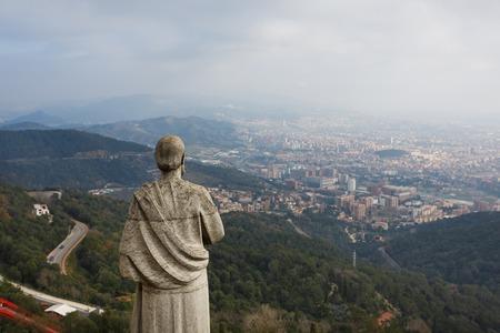 tibidabo: Statue on Tibidabo hill over the Barcelona city Stock Photo
