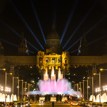 ray tracing: Barcelona, Spain - January 06 2017: Large group of people looks at the musical fountain of Montjuic near the National Art Museum of Catalonia at night Editorial
