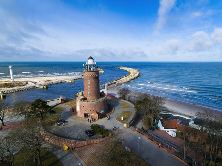 Lighthouse on the baltic seashore in a small resort town of Kolobrzeg in Poland, winter time Stock Photo - 73109726