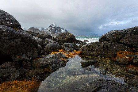 Landscape of Lofoten islands with reflection in a water on the foreground in winter Stock Photo