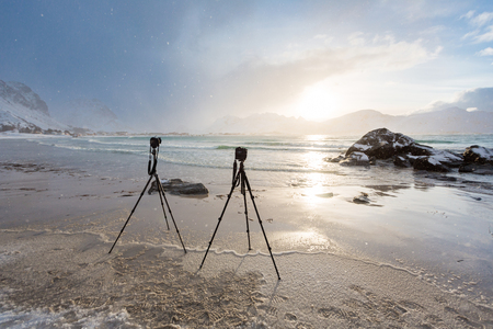 rack mount: Tripods with cameras on the shore of Lofoten islands in winter
