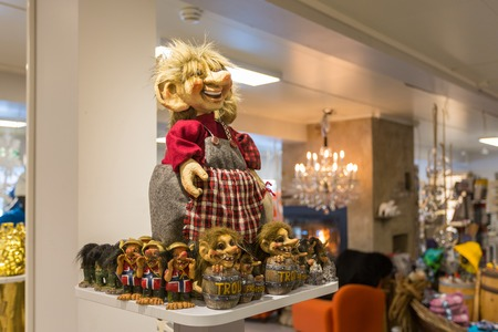 troll dolls: Leknes, Norway - March 19 2017: Traditional norwegian souvenirs on the showcase of tourist shop in Leknes town