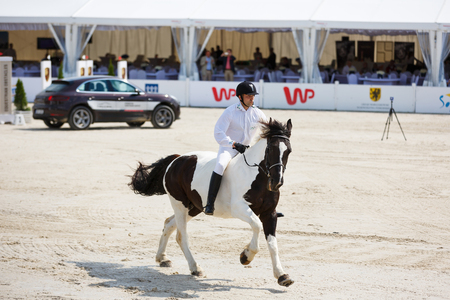 Sopot, Poland - June 10 2017: Horserider is jumping over obstacles in the arena during CSIO Sopot 2017 competitions