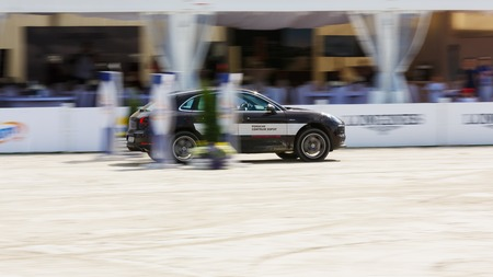 Sopot, Poland - June 10 2017: Porsche Cayenne bypass around the obstacles on the arena during the CSIO Sopot 2017 competition Editorial