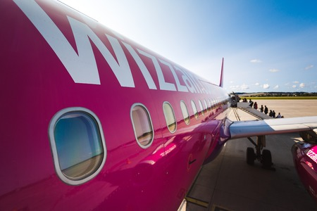 Gdansk, Poland, August 24 2017: People are boarding to the aircraft of Wizz Air at the airport of Lech Walesa