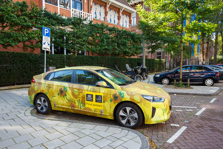 Amsterdam, Netherlands - August 23 2017: Advertising of Van Gogh Museum on the Hyundai electric car on the parking of Amsterdam
