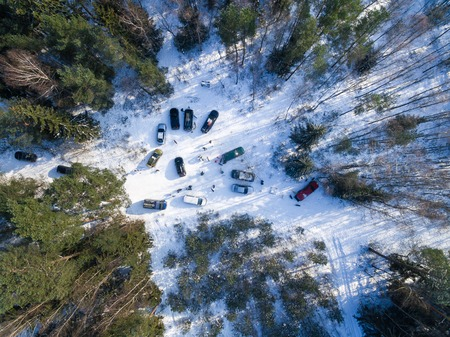 Aerial: Cars in the winter forest