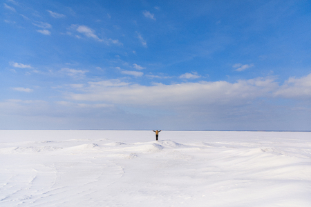 Woman on the frozen bay in winter Stock Photo