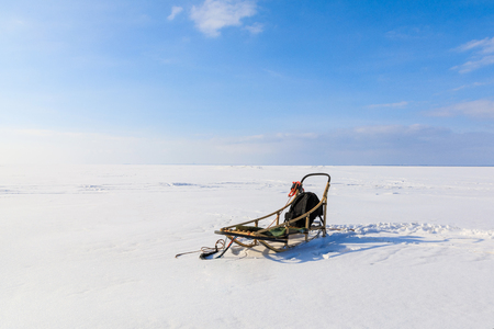 Sleigh without sled dogs on a frozen bay in winter Stock Photo