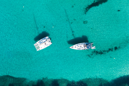 Aerial: Yachts in the azure water