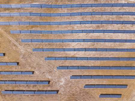 Aerial: Solar panels on a field Stock Photo