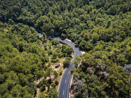 Aerial: Serpentine road in Mallorca, Spain Stock Photo