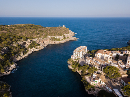 Aerial: Houses on the shore in Cala Figuera, Mallorca, Spain