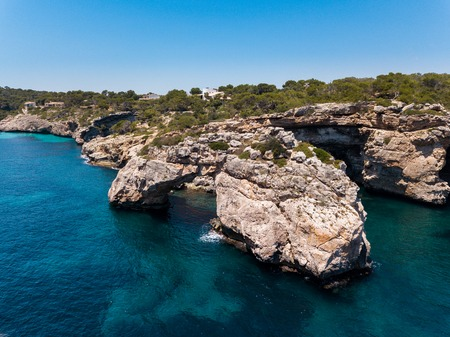 Aerial: Natural arch in the southeastern part of Mallorca Stock Photo