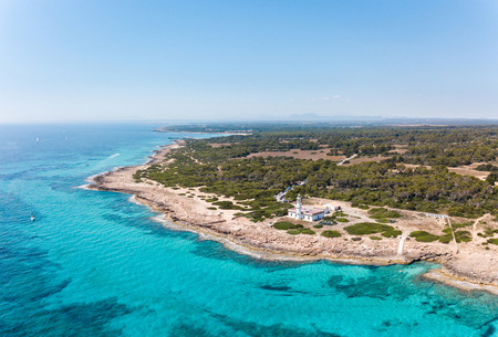 Aerial: Cape Ses Salines lighthouse in Mallorca Reklamní fotografie