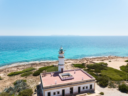 Aerial: Cape Ses Salines lighthouse in Mallorca Stock Photo