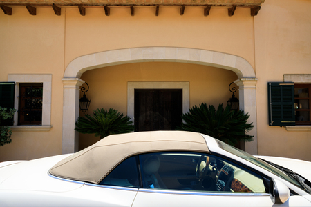 Entrance to the house with the car on the foreground