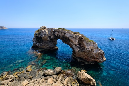 Natural arch nearby Cala Santanyi in Mallorca, Spain