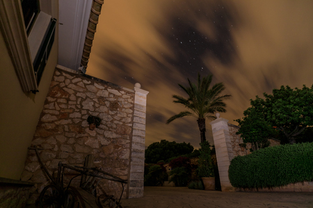 The spanish house under cloudy night sky, long exposure