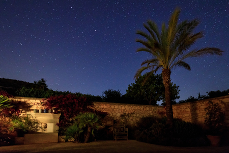 The courtyard of the spanish house under starry night sky Stock Photo