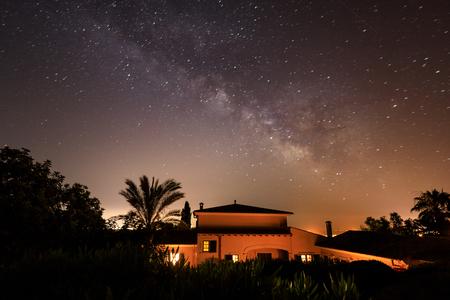 The spanish house under starry night sky Stock Photo