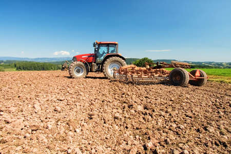 Tractor plowing a field in the Czech Republic Stock Photo - 6241083