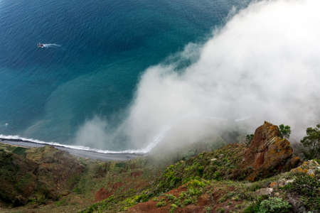 lofty: Cabo Girao is a lofty sea cliff located along the southern coast of the island of Madeira