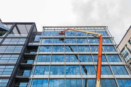 Washing windows on a high-rise building using a high-lift platform