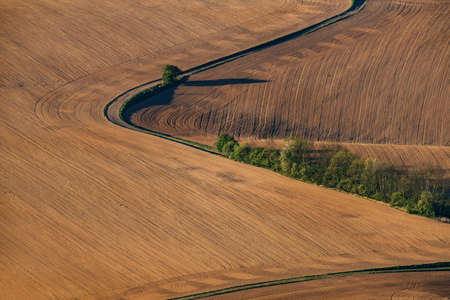 Road winding through spring fields in Bohemian paradise area on aerial photo. Reklamní fotografie
