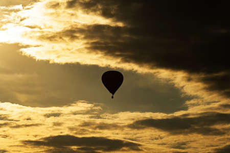 Hot air balloon on evening sky with clouds Reklamní fotografie - 161476270