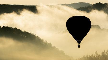 Hot air balloon floating in the morning light Reklamní fotografie