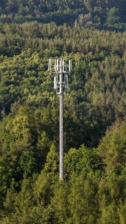 Telecommunication tower from with GSM network antennas Reklamní fotografie - 161476550