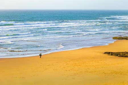 A fisherman heading  across his land