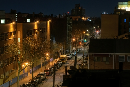 Calm and very quiet street during the night, Bronx, NY, USA