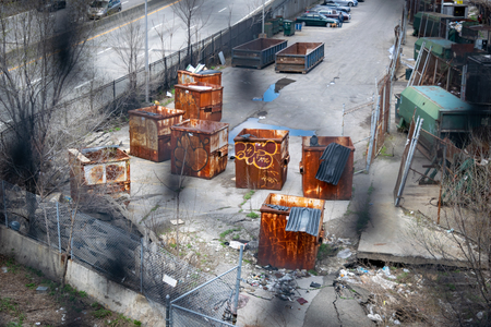 Old rusty construction containers and on a dilapidated back street in New York City, USA