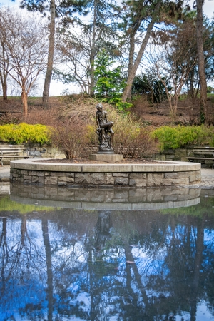 Bronze statue of that famous youth, Peter Pan, at Carl Schurz Park in New York City, NY, USA
